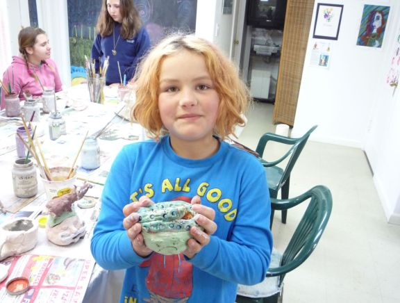 Budding young artists enjoys clay experience at the Santa Cruz Mountains Art Center, Ben Lomond, California